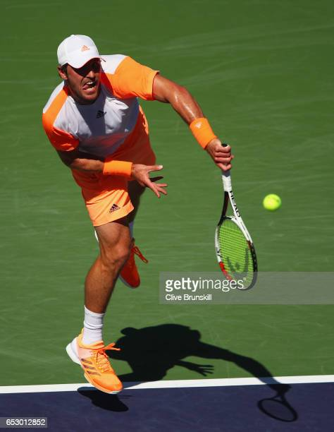 Mischa Zverev of Germany serves against Dominic Thiem of Austria in their third round match during day eight of the BNP Paribas Open at Indian Wells...