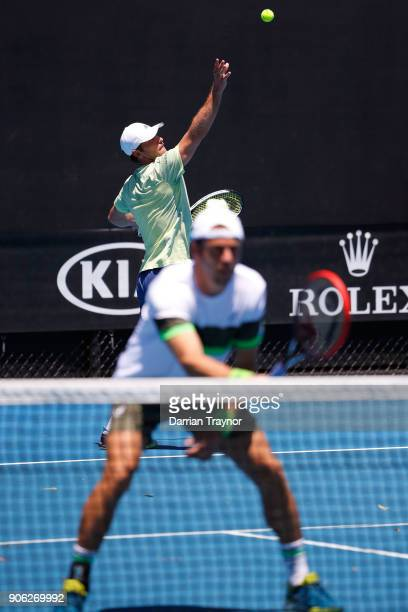Mischa Zverev of Germany serves in his first round men's doubles match with Paolo Lorenzi of Italy against Lukasz Kubot of Poland and Marcelo Melo of...