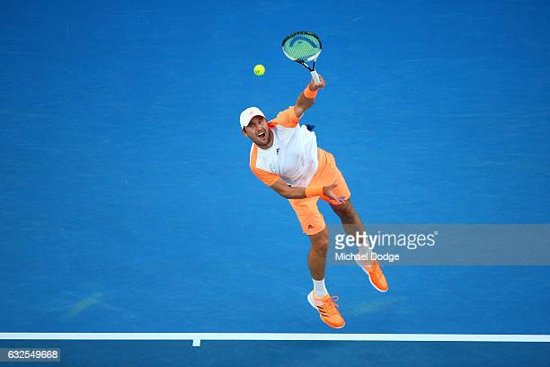 Mischa Zverev of Germany serves in his quarterfinal match against Roger Federer of Switzerland on day nine of the 2017 Australian Open at Melbourne...