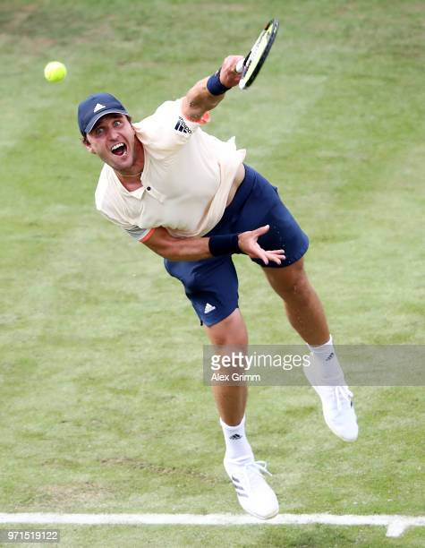 Mischa Zverev of Germany serves the ball to Mikhail Youzhny of Russia during day 1 of the Mercedes Cup at Tennisclub Weissenhof on June 11 2018 in...