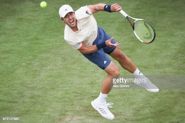 Mischa Zverev of Germany serves the ball to Roger Federer of Switzerland during day 3 of the Mercedes Cup at Tennisclub Weissenhof on June 13 2018 in...