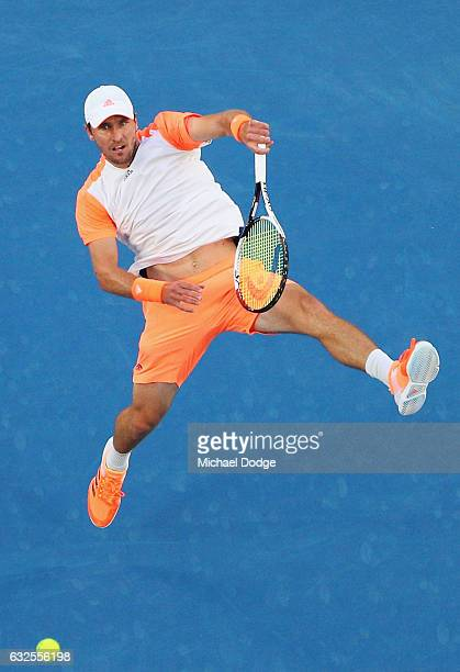 Mischa Zverev of Germany smashes a lob in his quarterfinal match against Roger Federer of Switzerland day nine of the 2017 Australian Open at...