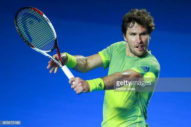 Mischa Zverev of Germany takes a backhand shot during a match between Juan Martin del Potro of Argentina and Mischa Zverev of Germany as part of the...