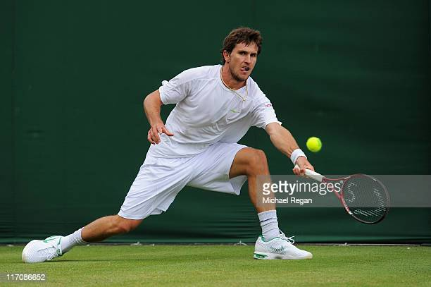 Mischa Zverev of Russia returns a shot during his first round match against Xavier Malisse of Belgium on Day Two of the Wimbledon Lawn Tennis...