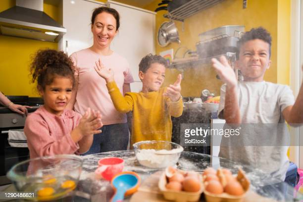 mischief in the kitchen! - pancakes stock pictures, royalty-free photos & images