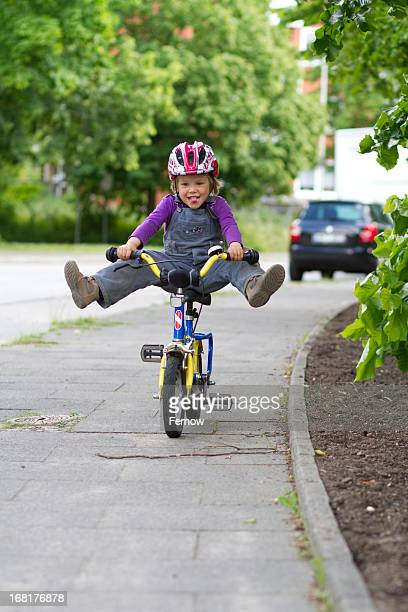 mischievous toddler on a bike - girls open legs stock photos and pictures