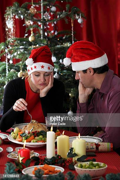 miserable couple having christmas dinner