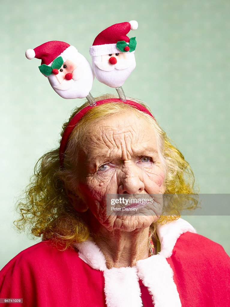 Miserable mother in law, dressed as Santa Claus.  : Stock Photo