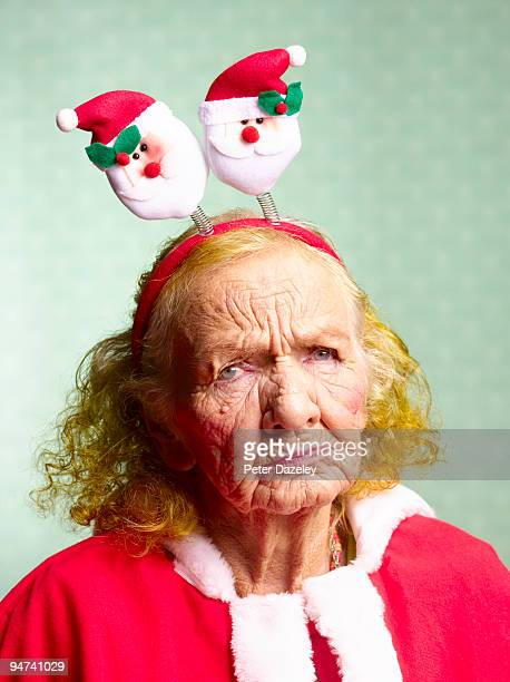 miserable mother in law, dressed as santa claus.  - mother in law stock pictures, royalty-free photos & images
