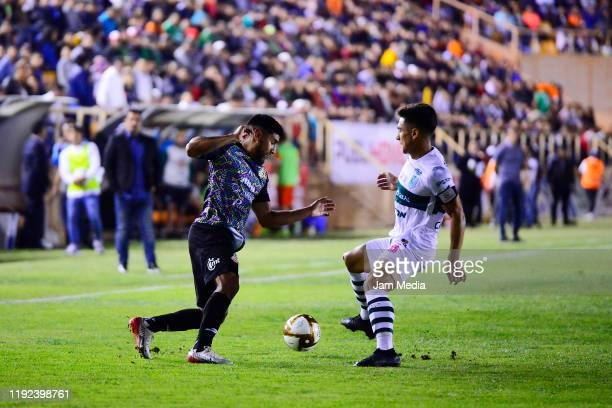 Mises Velasco of Alebrijes fights for the ball with Adrián Cirigliano of Zacatepec during the Final second leg match between Alebrijes de Oaxaca and...