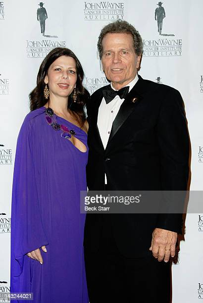 Misha and Patrick Wayne arrive at John Wayne Cancer Institute's 27th Annual Odyssey Ball at The Beverly Hilton Hotel on April 21 2012 in Beverly...
