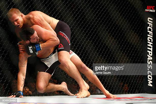 Misha Cirkunov of Latvia holds Alex Nicholson in their light heavyweight bout during the UFC Fight Night event at MGM Grand Garden Arena on February...