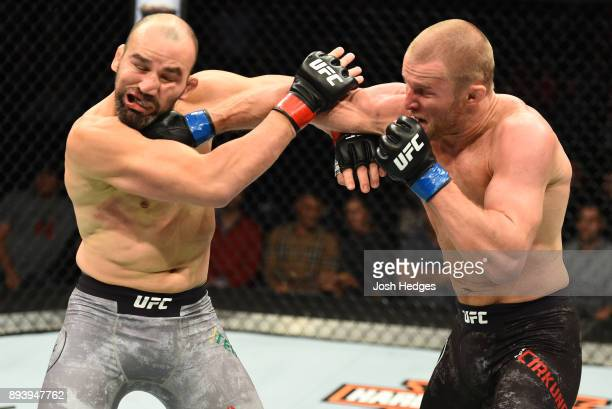 Misha Cirkunov of Latvia punches Glover Teixeira of Brazil in their light heavyweight bout during the UFC Fight Night event at Bell MTS Place on...