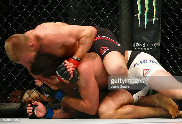 Misha Cirkunov of Latvia submits Alex Nicholson in their light heavyweight bout during the UFC Fight Night event at MGM Grand Garden Arena on...