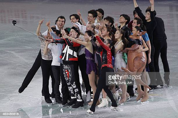 Misha Ge of Uzbekistan takes a selfie with other skaters after the Gala Exhibition on day four of the ISU Four Continents Figure Skating...