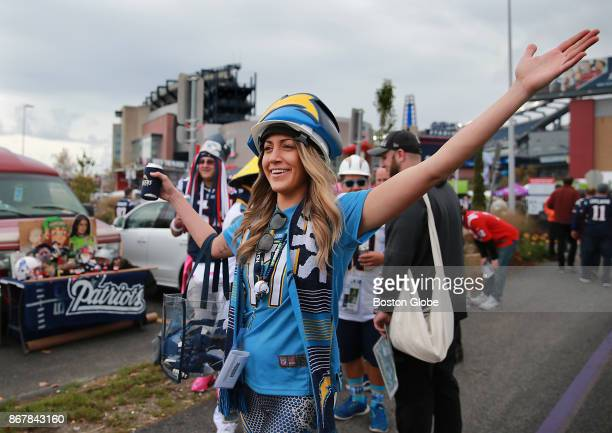 Misha Zeineddine a San Diego Chargers fan from New York City discovers a fellow Chargers fan in the parking lot before they play the New England...