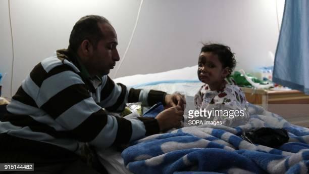Mishaan al Abed feeds his threeyearold daughter Sarah at Bekaa Hospital in Lebanon Sarah was among the survivors of a snowstorm that killed 16...