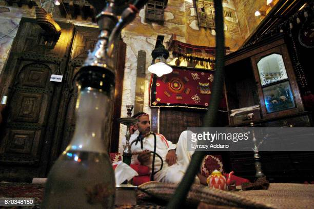 Mishari Al Thaybi a journalist sits in a restaurant with a waterpipe in Jeddah Saudi Arabia December 19 2003 Mishari was one of many religious...