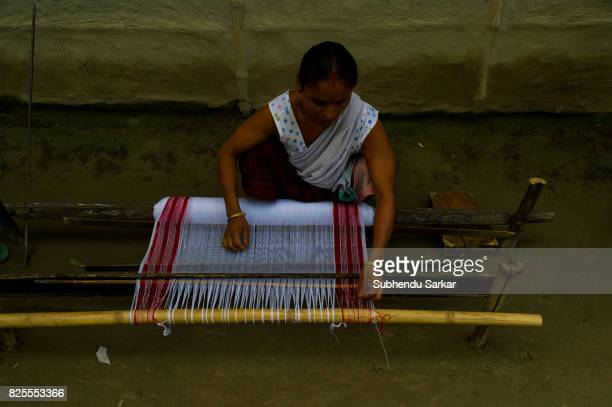 Mishing woman works on handloom to make towel The Mishings are the largest ethnic tribal community living in the northeast India