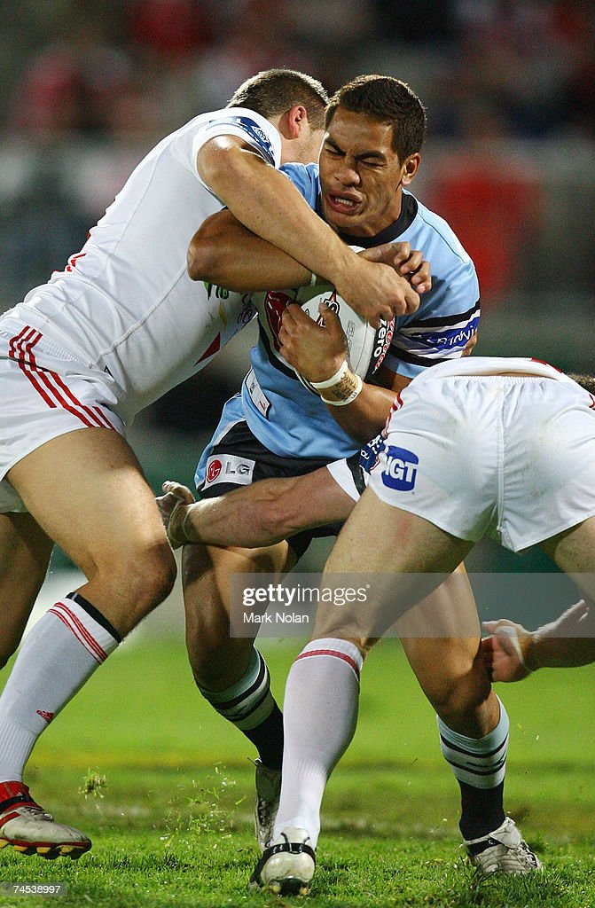 Misi Taulapapa of the Sharks is tackled during the round 13 NRL match between the St George Illawarra Dragons and the Cronulla Sharks at OKI Jubilee Stadium June 11, 2007 in Sydney, Australia.