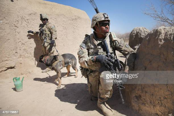 Misiri Parker from Zion Illinois with the US Army's 4th squadron 2d Cavalry Regiment keeps watch while SRA Brandon Hinton from Oklahoma City Oklahoma...