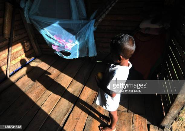 A Miskito child watches his baby brother at his home in Prumnitara Puerto Lempira Honduras on July 8 2019 Thousands of fishing divers of the...