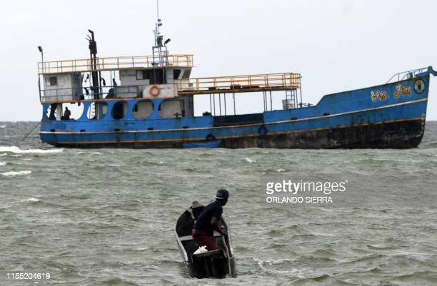A Miskito fisher rides a bote toward a fishing vessel offshore Prumnitara Puerto Lempira Honduras on July 8 2019 Thousands of fishing divers of the...