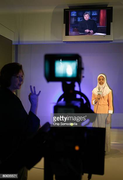 "Misky Sharif of Lansdowne, Virginia, reads a news script for the television camera in the ""Be A TV Reporter"" section of The Newseum during its grand..."