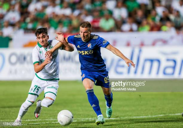 Mislav Orsic of Dinamo Zagreb and Loizos Loizou of Omonia in acton during the UEFA Champions League Second Qualifying Round match between GNK Dinamo...