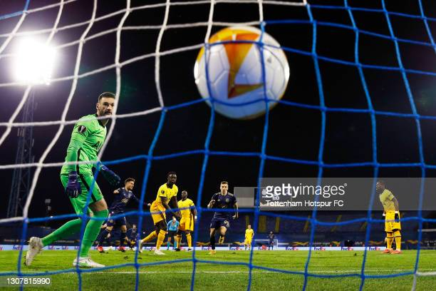 Mislav Orsic of GNK Dinamo Zagreb celebrates and runs to collect the ball after scoring their side's second goal past Hugo Lloris of Tottenham...