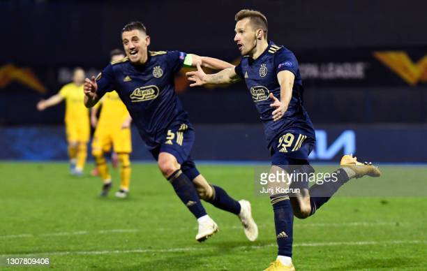 Mislav Orsic of GNK Dinamo Zagreb celebrates with Arijan Ademi after scoring their side's third goal and his hat-trick during the UEFA Europa League...
