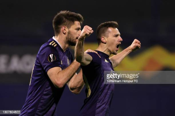 Mislav Orsic of GNK Dinamo Zagreb celebrates with Bruno Petkovic after scoring their side's second goal during the UEFA Europa League Round of 16...