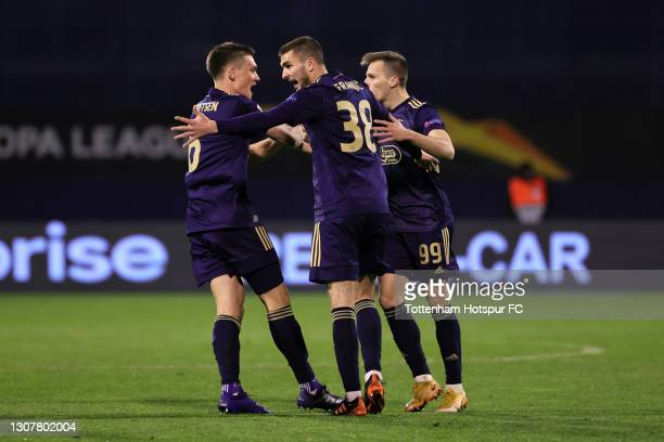 Mislav Orsic of GNK Dinamo Zagreb celebrates with Rasmus Lauritsen and Bartol Franjic after scoring their side's first goal during the UEFA Europa...