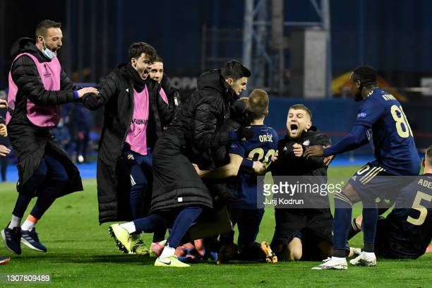 Mislav Orsic of GNK Dinamo Zagreb celebrates with team mates after scoring their side's third goal and his hat-trick during the UEFA Europa League...
