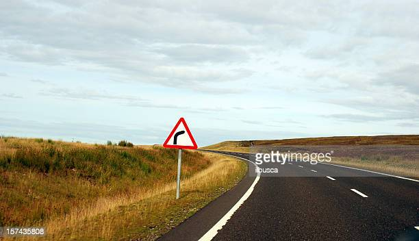 misleading sign in the highlands, scotland - illusion stock pictures, royalty-free photos & images
