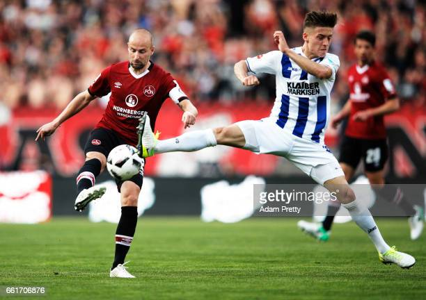 Miso Brecko of 1FC Nuernberg is challenged by Marvin Mehlem of Karlsruher SC during the Second Bundesliga match between 1 FC Nuernberg and Karlsruher...