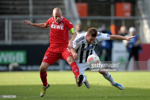 Miso Brecko of Cologne and Michael Klauss of Aalen battle for the ball during the Second Bundesliga match between VfR Aalen and 1 FC Koeln at...