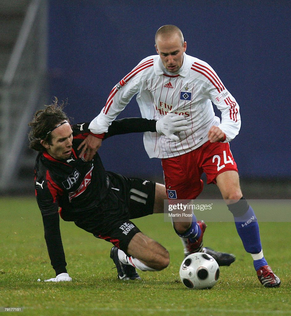 Miso Brecko (R) of Hamburg and Petter Furuseth (R) of Midtjyland compete for the ball during the friendly match between Hamburger SV and FC Midtjyland at the HSH Nordbank Arena on January 23, 2008 in Hamburg, Germany.