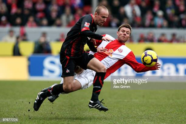 Miso Brecko of Koeln is challenged by Florian Heller of Mainz during the Bundesliga match between FSV Mainz 05 and 1 FC Koeln at the Bruchweg Stadium...