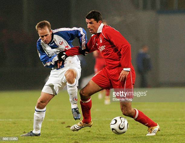 Miso Brecko of Rostock and Roy Makaay of Bayern compete during the friendly match between FC Hansa Rostock and Bayern Munich at the Ostsee Stadium on...