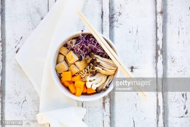 miso ramen soup with noodles, hokaido pumpkin, red radish sprouts, fried tofu, shimeji mushroom and king trumpet mushroom - shimeji mushroom stock pictures, royalty-free photos & images