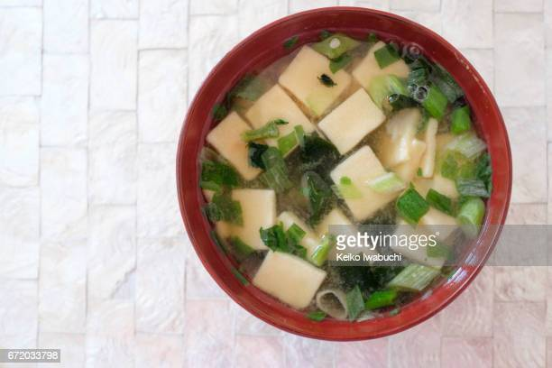 miso soup with tofu and leeks - miso sauce stock pictures, royalty-free photos & images