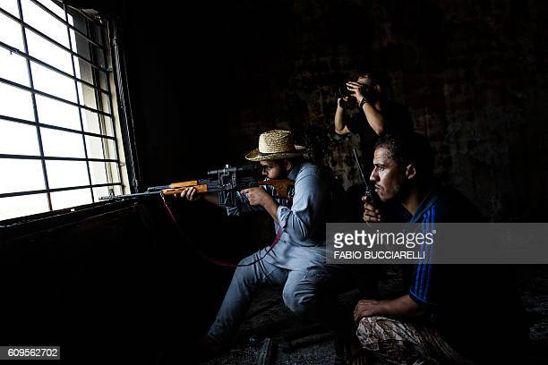 Misrata's sniper shoots toward Islamic State group positions in Sirte Libya on September 21 2016 The forces of AlBonyan AlMarsous operation...