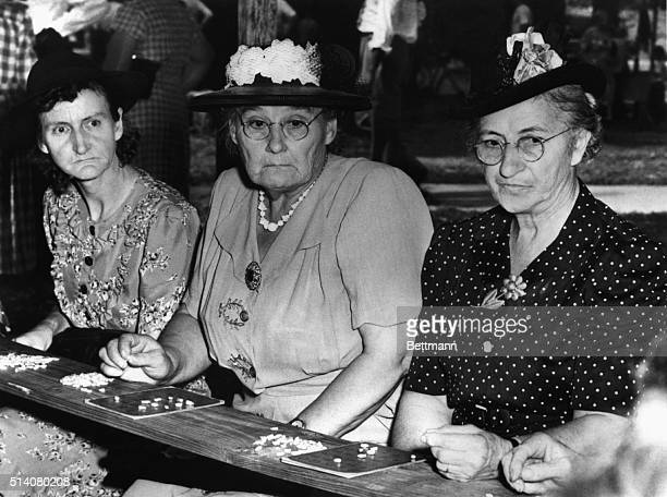 Miss Adeline Backhaus Mrs WH Lorber and Mrs Frances Rufkahr all look on in disappointment and disgust at the winner of the St Charles Missouri...
