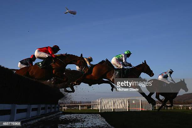 Miss AE Stirling riding Perfect Candidate clears the water jump in the Toby Balding Hunt Steele Chase Amateur Riders Race on day one at Cheltenham...