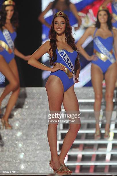 Miss Alsace Delphine Wespiser walks along the stage during Miss France 2012 Beauty Pageant on December 3 2011 in Brest France