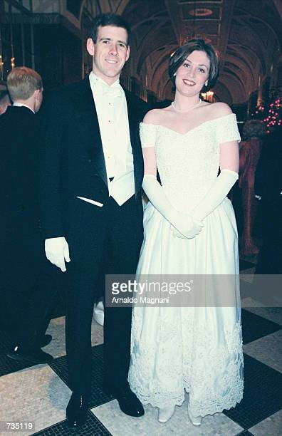 Miss Amelia Eisenhower Mahon and her escort Bruce Kennedy pose for photographers December 29 20000 while attending the 46th International Debutante...