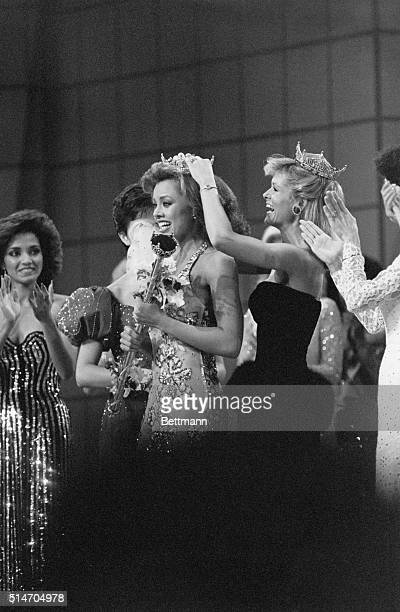 Miss America 1983 Debra Maffett crowns Vanessa Williams as Miss America 1984 at the pageant in Atlantic City. Williams was the first African American...