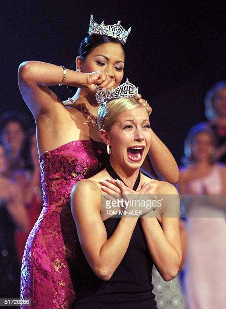 Miss America 2002 Katie Harman reacts as she is crowned by last year's winner Angela Perez Baraquio at the conclusion of the Miss America Pageant 22...