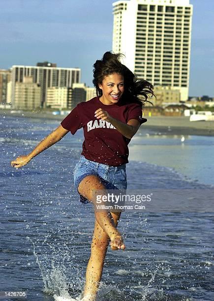 Miss America 2003 Erika Harold plays in the surf of the Atlantic Ocean September 22 2002 in Atlantic City New Jersey Harold won the Miss America...